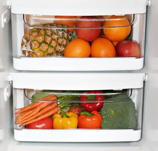 Fruit and vegetables in a fridge.