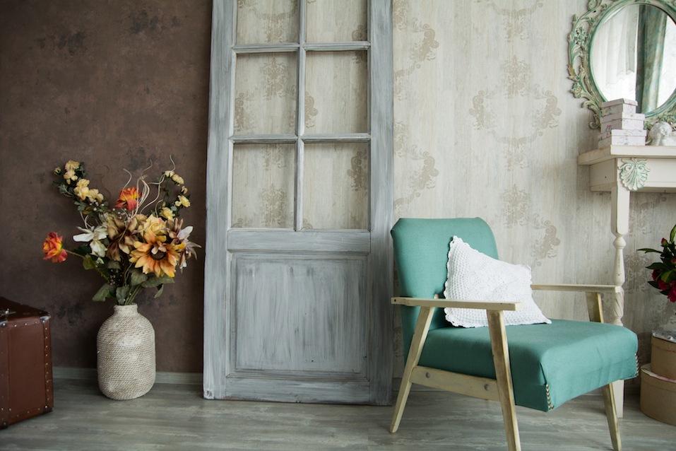 Interior retro room with an armchair