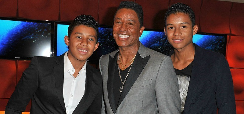 Jermaine, Jafaar, and Jermajesty pose together smiling.