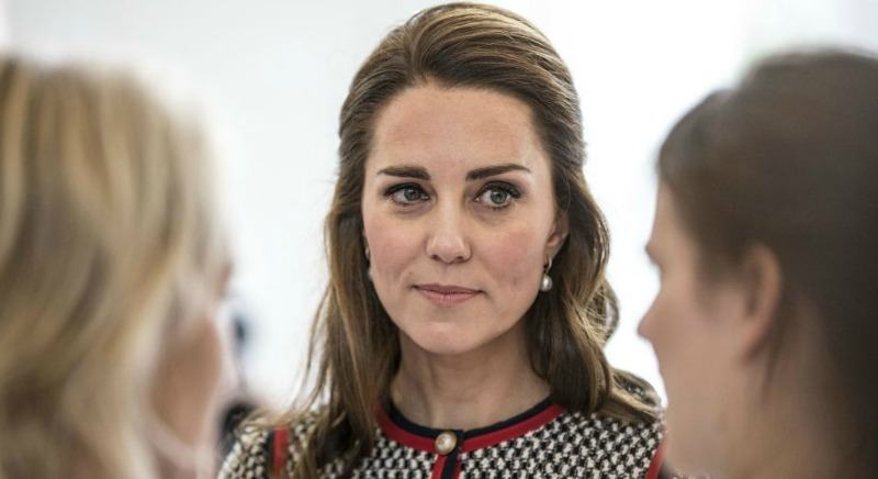 Kate Middleton looks serious as she is looking at another woman.