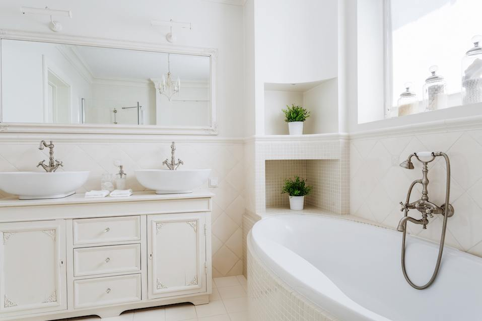 white bathroom with two sinks and big mirror