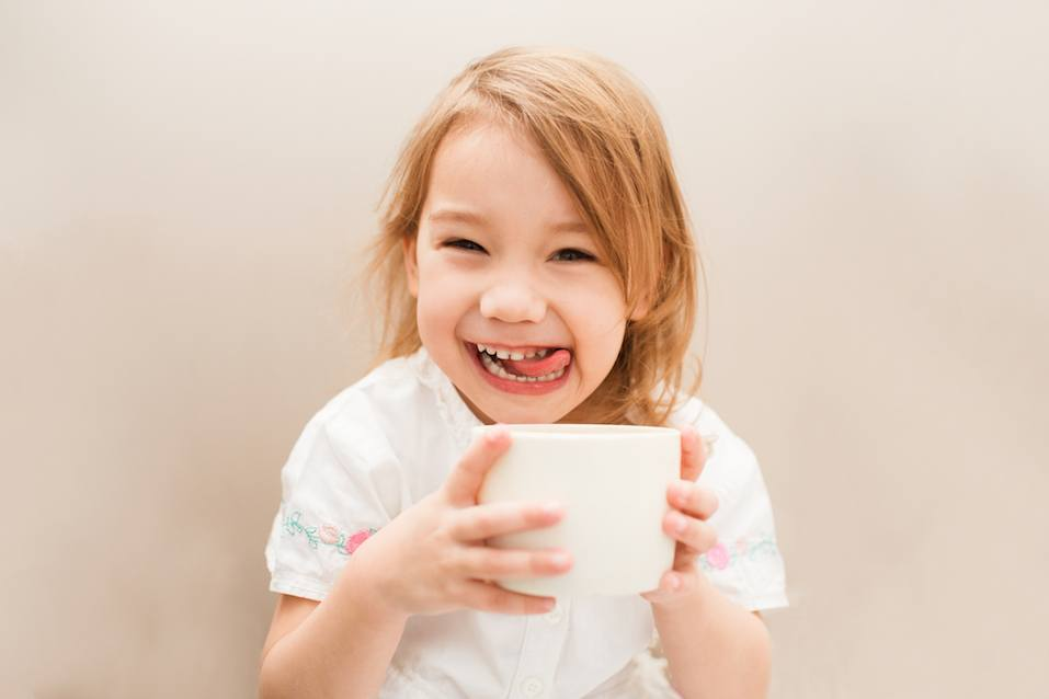 Little cute and sweet girl with tea