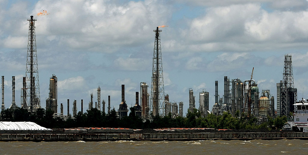 Barges loaded with coal are seen in front of the ConocoPhillips Alliance Refinery in Louisiana