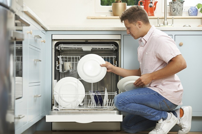 Man loading dishwasher