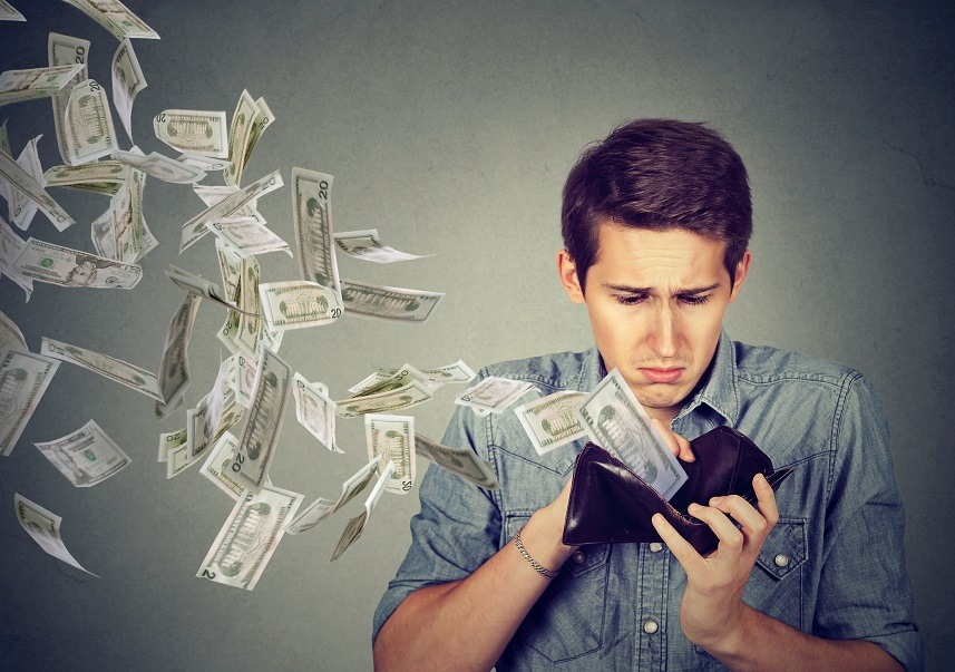 Sad man looking at his wallet