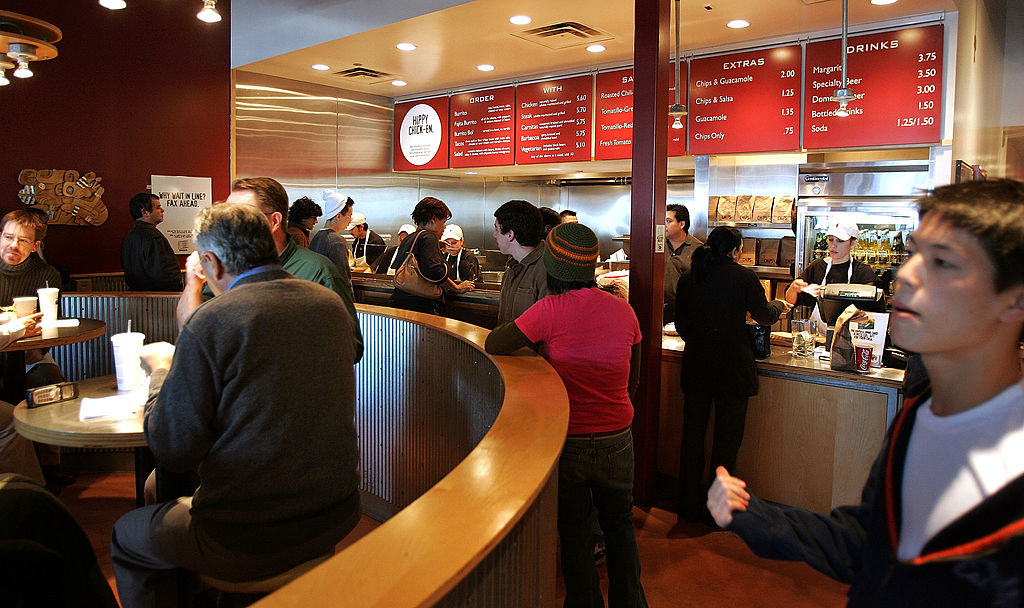 Activity is seen near the order-counter area inside a Chipotle restaurant