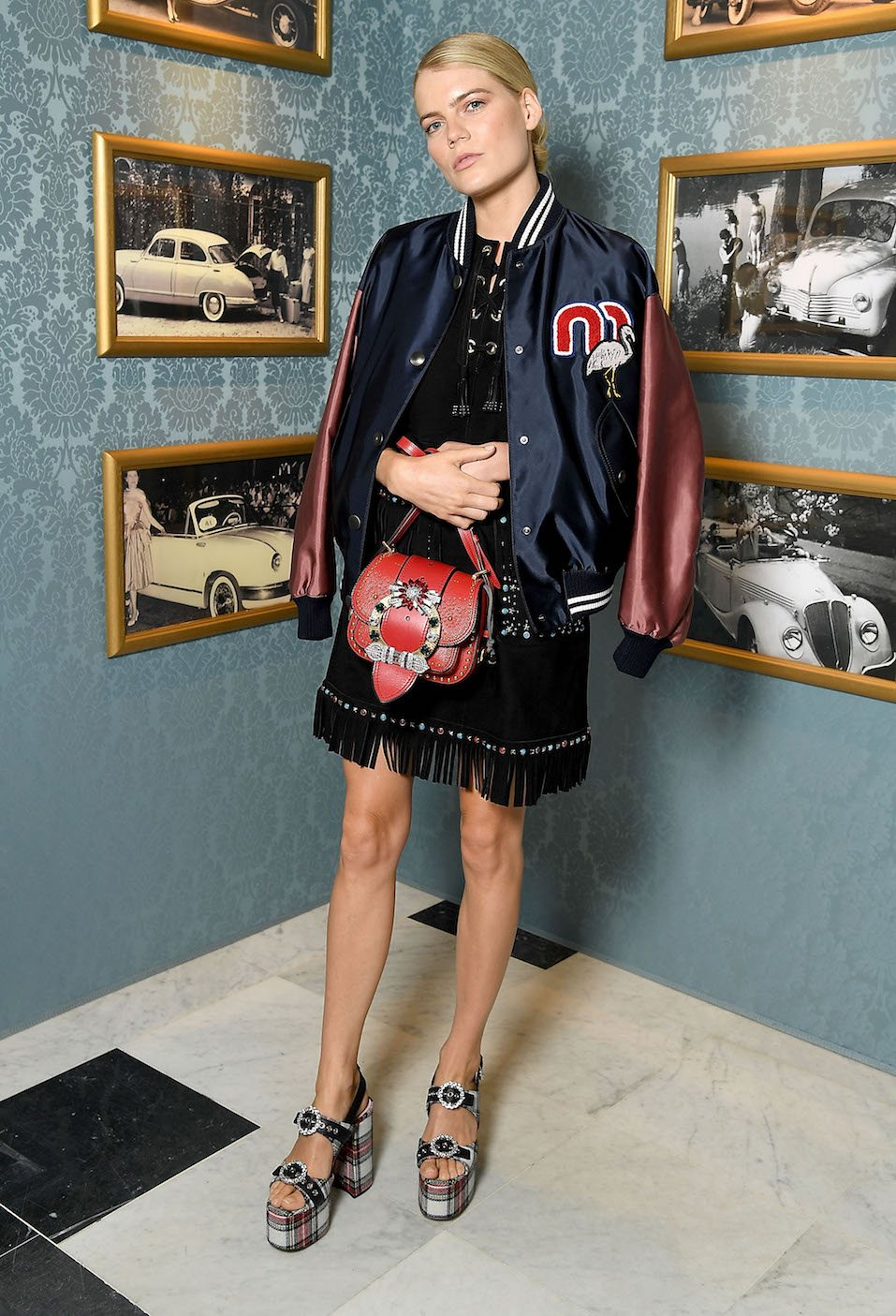 Emma Greenwell attends Miu Miu Cruise Collection show