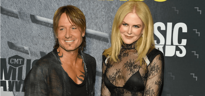Keith Urban and Nicole Kidman pose together on the red carpet.