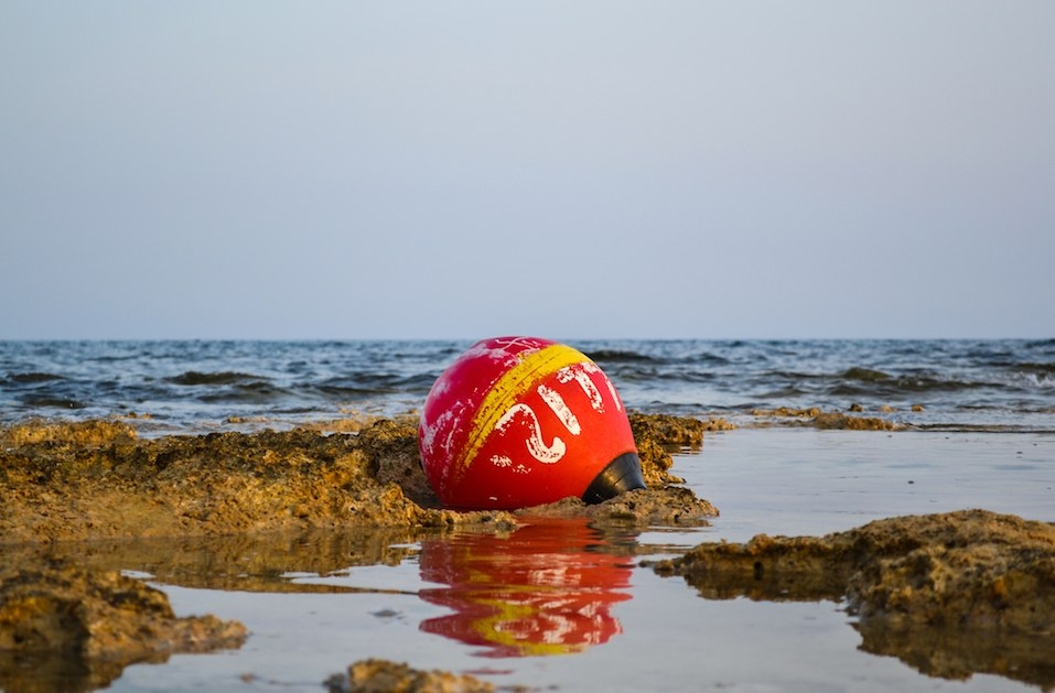Old buoy of red color