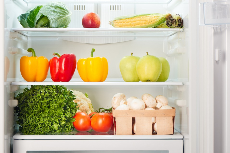 Open refrigerator full of fruits and vegetables