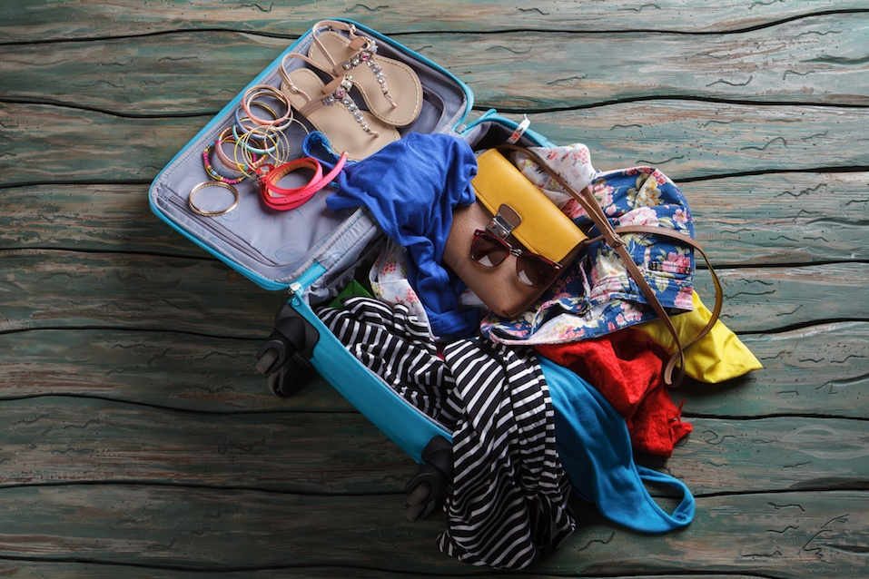 Open suitcase with crumpled clothes