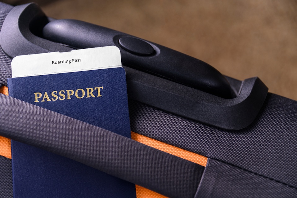 Boarding pass and a passport on a suitcase