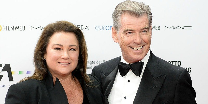 Pierce Brosnan and Keely Shaye Smith pose together on the red carpet.