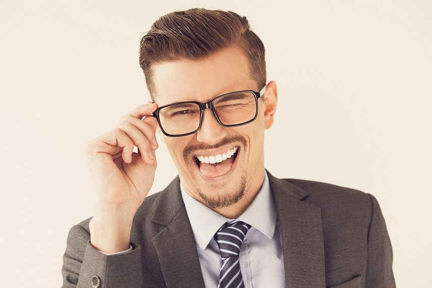 young businessman adjusting eyeglasses