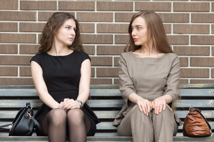 two business rivals women looking at each other