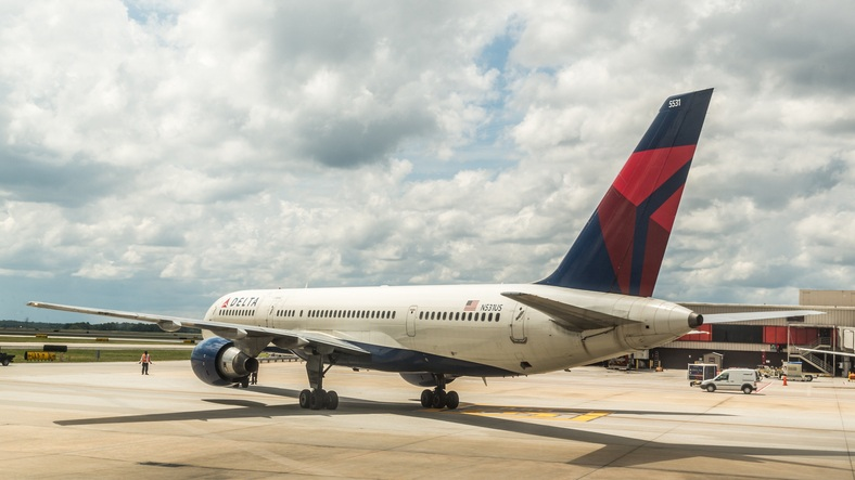 delta air plane out of its departure gate
