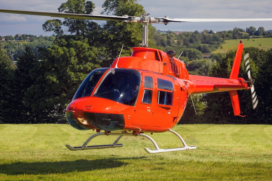 A private helicopter takes off / lands on grass