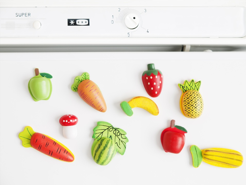 Refrigerator magnets shaped like fruit