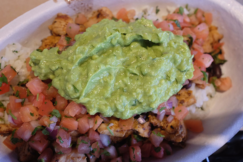 Guacamole sits on a dish at a Chipotle restaurant