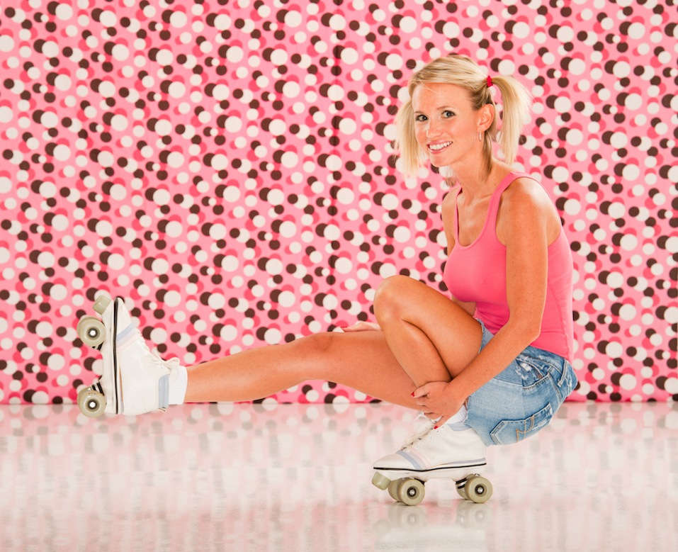 Retro roller skating woman, against a retro polka dot background