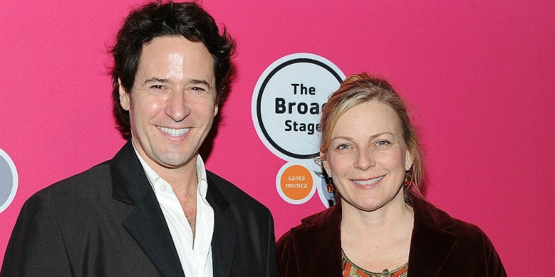 Rob Morrow and Debbon Ayer pose together on the red carpet.