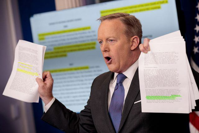 Sean Spicer holding papers