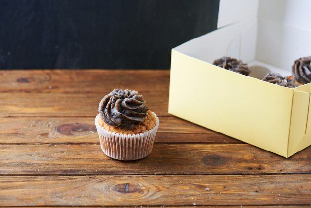 Single chocolate cup cake over paper box.