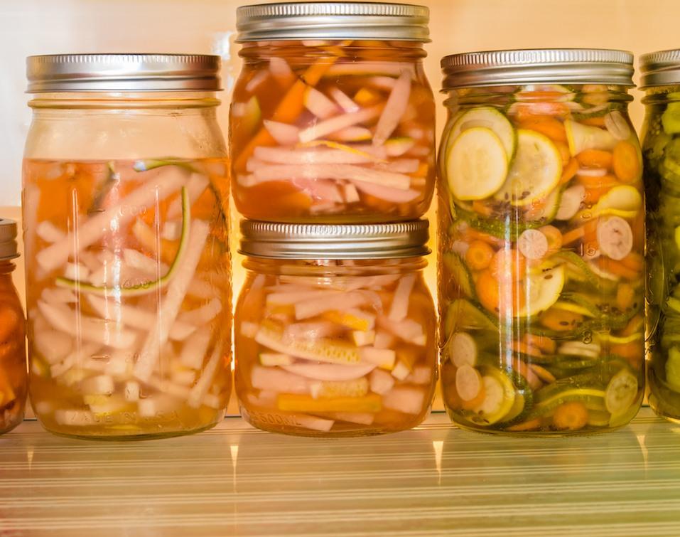 Sliced vegetables being pickled