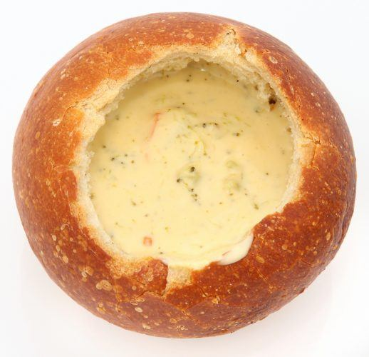 Sourdough bread filled with broccoli cheese soup