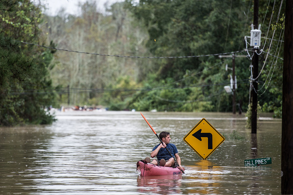 A man paddles around during a flood in South Carolina