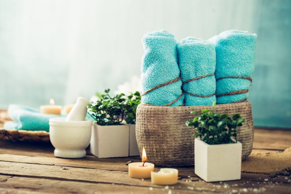 Spa and wellness setting with flowers and towels