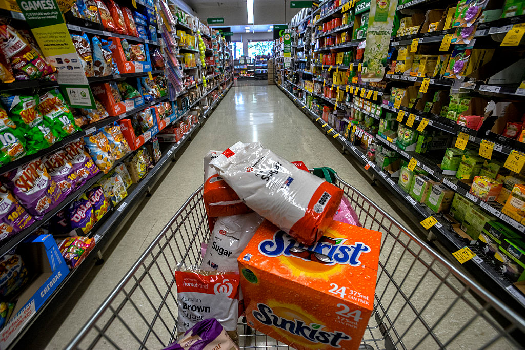 Products containing high sugar levels are on display at a supermarket