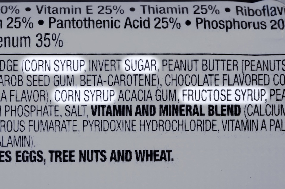 ingredients list of granola health bar with forms of sugar highlighted
