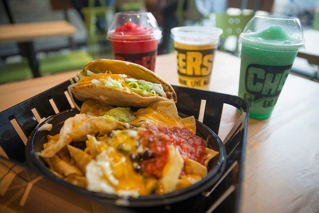Taco Bell products on a wooden table.