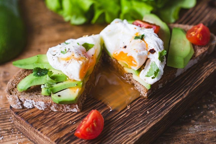 Poached egg, avocado toast sandwich