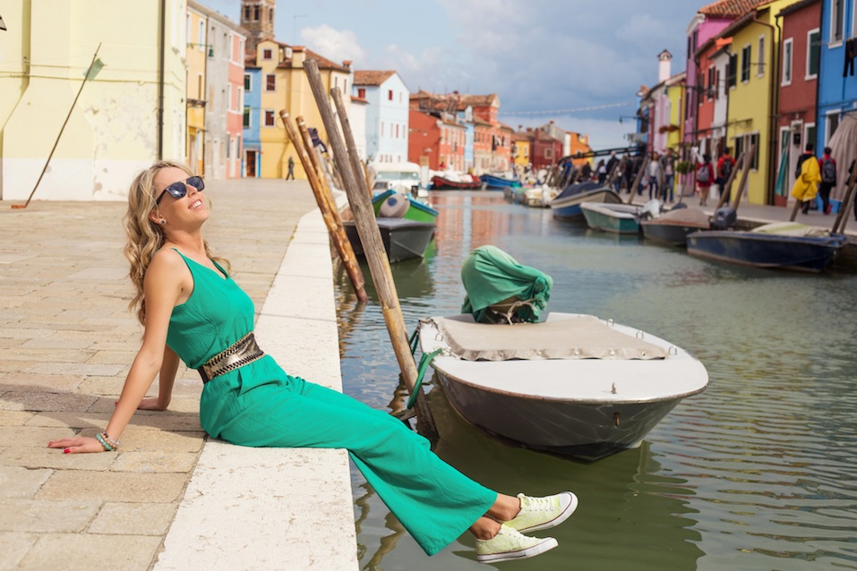 Tourist enjoying romantic Burano island of Venice in Italy