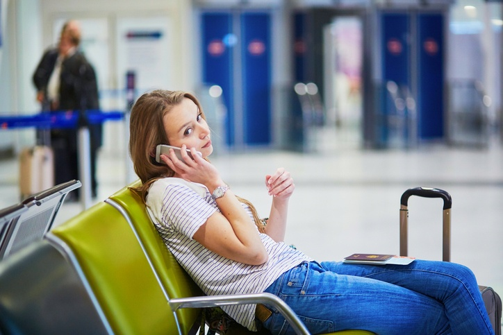 Tourist girl in international airport, waiting for her flight