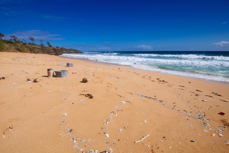 garbage strewn beach on Kauai