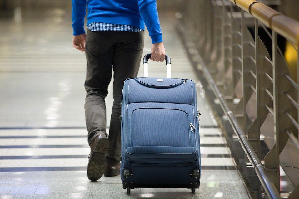 Traveler pulling suitcase