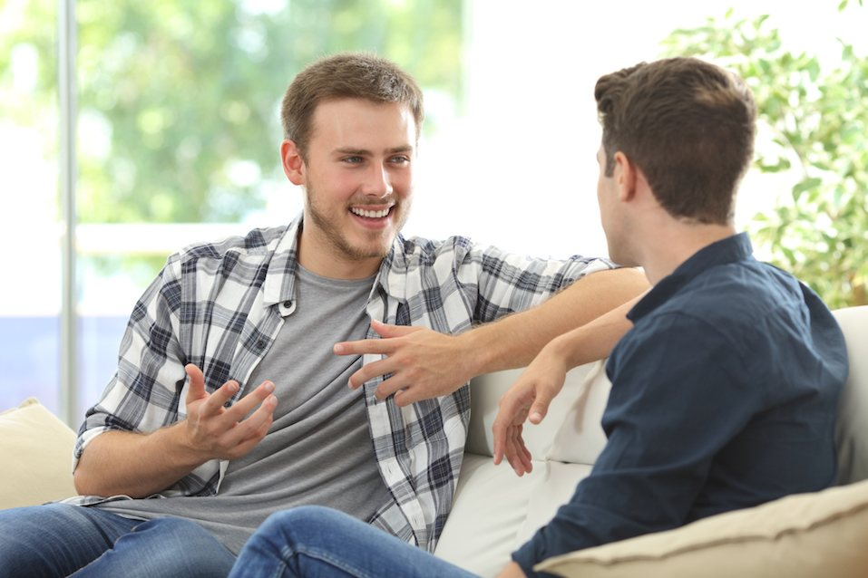 Two friends talking at home