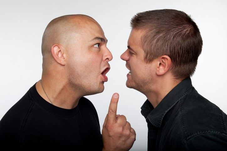 Two guys having an argument in each other's faces