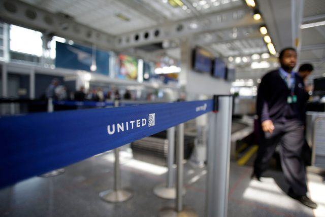 An airport worker walks through the United Airlines terminal at O'Hare International Airport
