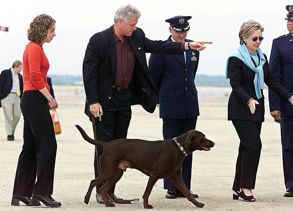 US President Bill Clinton (2nd-L) orders first dog