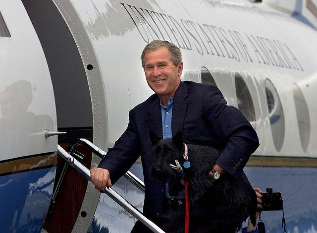 US President George W. Bush holds his pet dog Barn