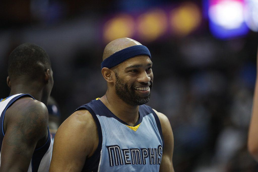 Vince Carter smiles during a game against the Mavs.