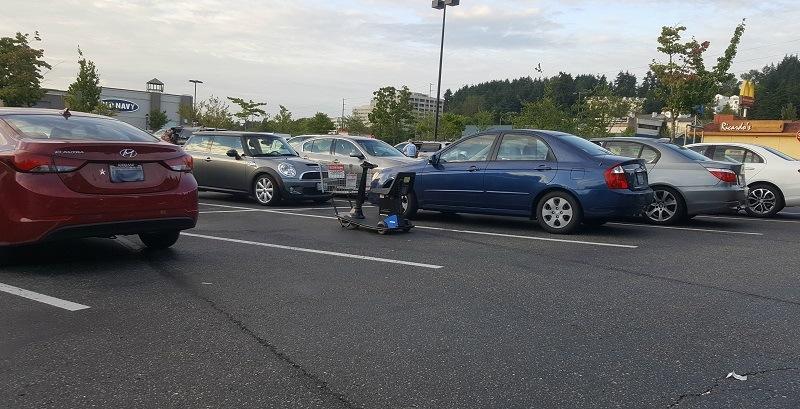 A motorized cart in a Walmart parking spot