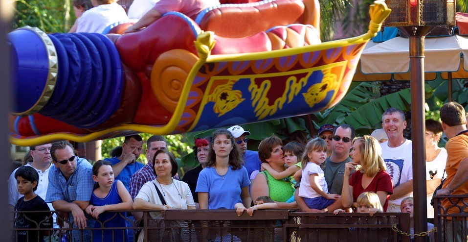 People stand in line to ride The Magic Carpets of Aladdin ride at Walt Disney World's Magic Kingdom