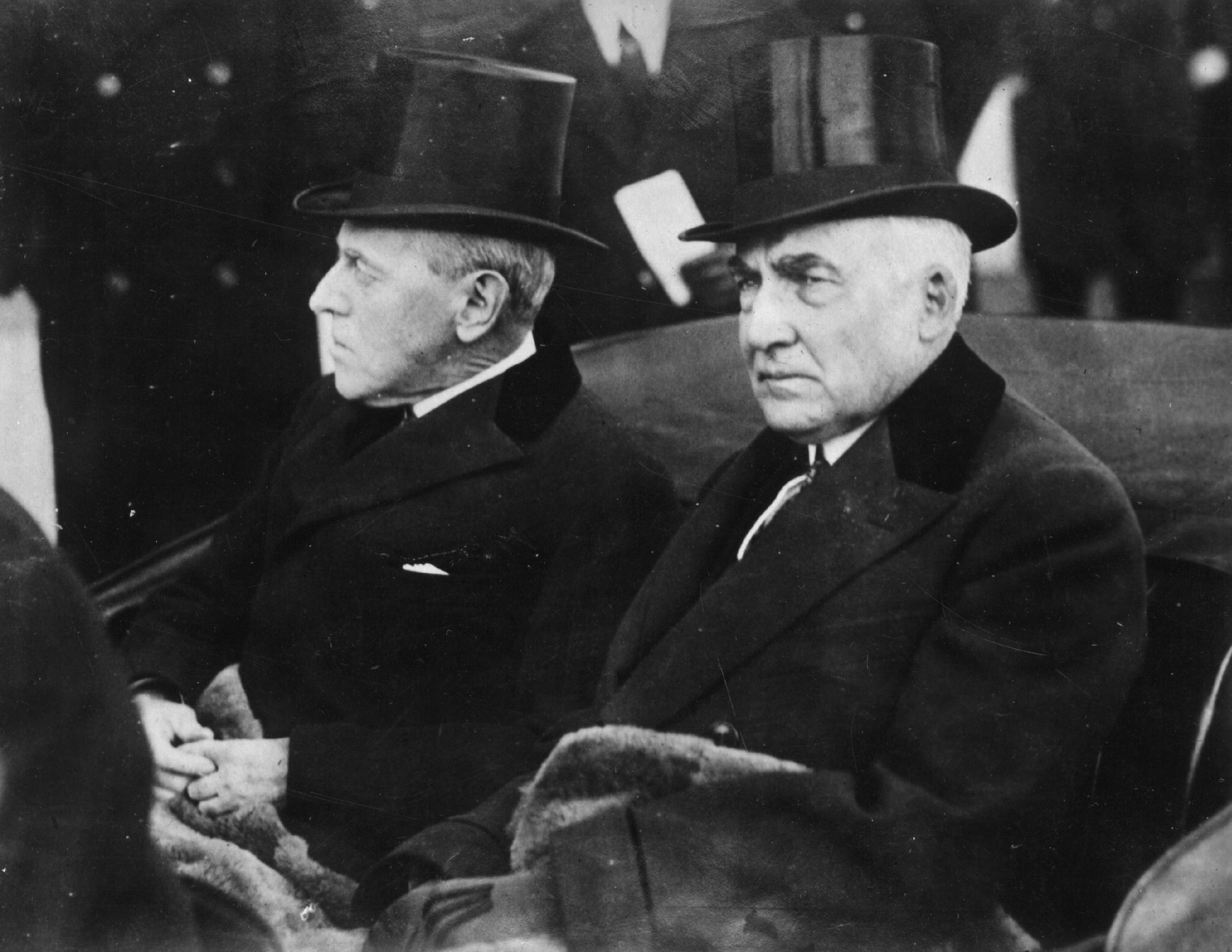Warren Gamaliel Harding (1865 - 1923), the 29th President of the United States of America, riding in a carriage with the former President Woodrow Wilson