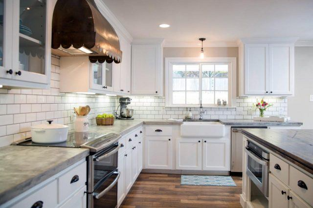 A close-up of a newly renovated kitchen with white cabinets on HGTV's 'Fixer Upper'