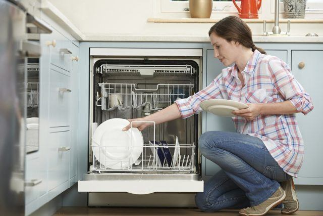 Woman Loading Dishwashwasher